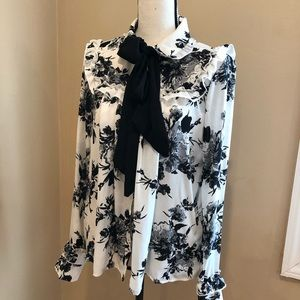 White blouse with black printed flowers